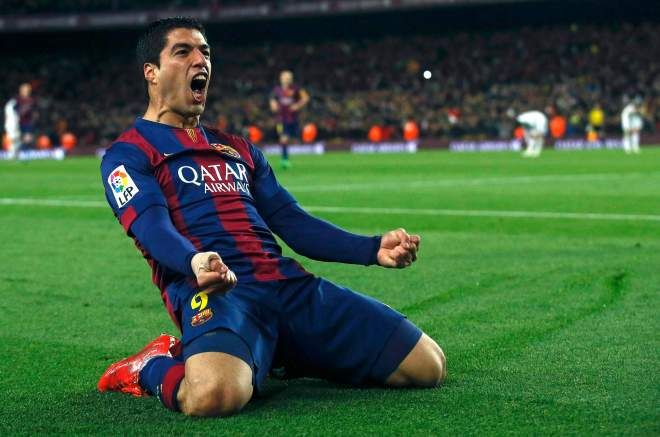 "Barcelona's Suarez celebrates after scoring a goal against Real Madrid during their Spanish first division ""Clasico"" soccer match at Camp Nou stadium in Barcelona"